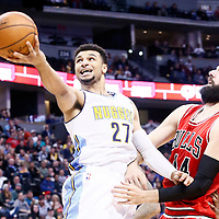 22 November 2016: Denver Nuggets guard Jamal Murray (27) is fouled by Chicago Bulls forward Nikola Mirotic (44) and Chicago Bulls forward Jimmy Butler (21) during the Denver Nuggets 110-107 victory over the Chicago Bulls, at the Pepsi Center, Denver, Colorado, USA.