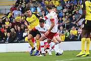 Rotherham United defender Richard Wood (6) tackles Burton Albion midfielder Scott Fraser (8) but no penalty is awarded during the EFL Sky Bet League 1 match between Burton Albion and Rotherham United at the Pirelli Stadium, Burton upon Trent, England on 17 August 2019.