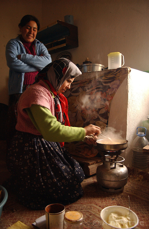 Ali Ipak 's wife Ayse and daughter Emel, (in blue) prepare lunch December 12, 2005 in central Turkey, Konya in Kutoren district, about 400 kilometers from Ankara.  (Ami Vitale)