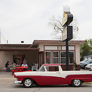 A 1957 Ford Ranchero truck in Lexington, Illinois on historic U.S. Route 66. The Mother Road starts in Chicago traveling through 6 states and ending in Santa Monica, California.<br /> Photography by Jose More
