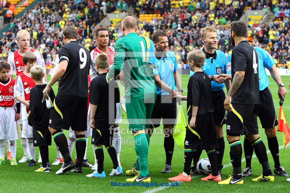 Picture by Paul Chesterton/Focus Images Ltd +44 7904 640267.31/07/2012.The players from both sides shake hands before the Friendly match at Carrow Road, Norwich.
