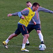NLD/Katwijk/20110321 - Training Nederlandse Elftal Hongarije - NLD, John Heitinga en Raphael van der Vaart in duel