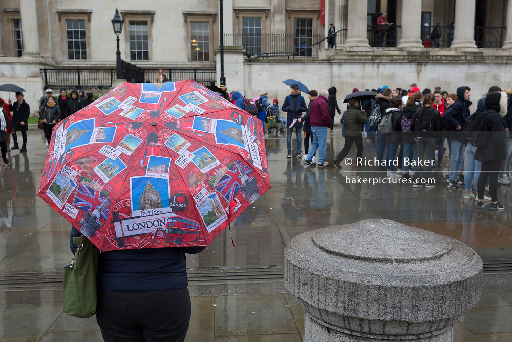 A London tourist's umbrella in Trafalgar Square, Westminster, on 9th April 2019, in London, England.