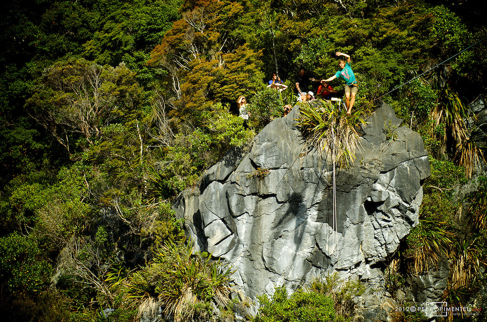Florian Herla making the first steps on the scary Harwoods hole Highline. New Zealand.