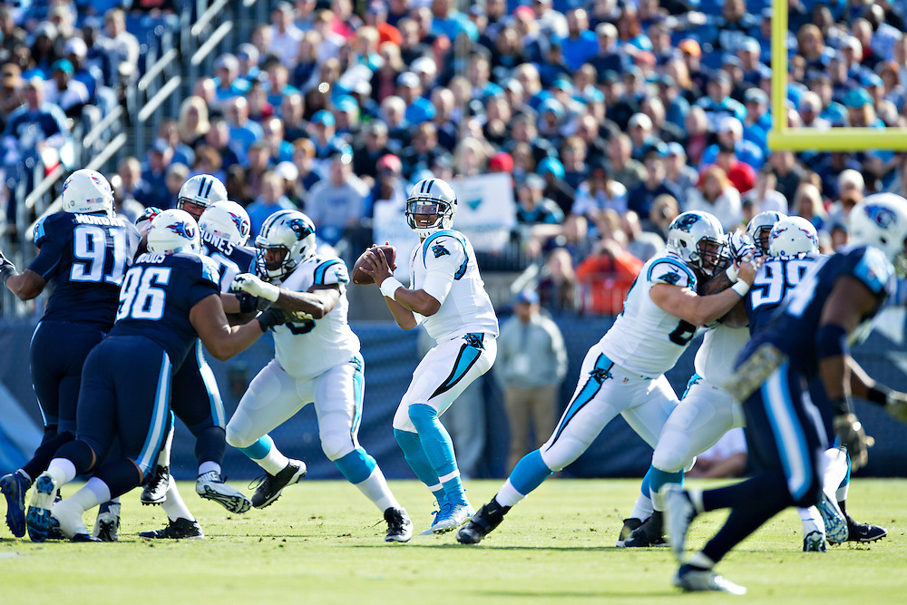 NASHVILLE, TN - NOVEMBER 15:  Cam Newton #1 of the Carolina Panthers drops back to pass and looks downfield for a receiver during a game against the Tennessee Titans at Nissan Stadium on November 15, 2015 in Nashville, Tennessee.  (Photo by Wesley Hitt/Getty Images) *** Local Caption *** Cam Newton