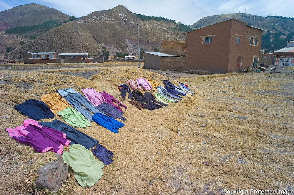 Wash laied out to dry on ground, Sicuani, Cusco, Peru