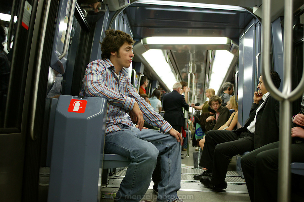 Evan Menzel on the Metro (underground) Paris, France.