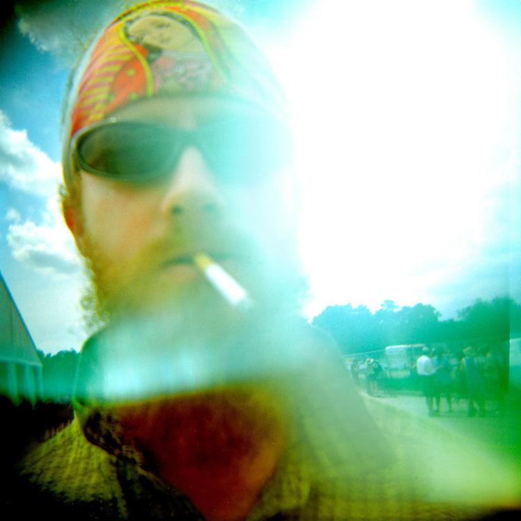 Christopher Reynolds, of Baltimore, MD, enjoys Jazz Fest 2004 in New Orleans, LA.