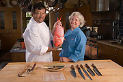 Cindy Pawlcyn and Ken Tominaga with a redfish that will be used for sushi in their new Napa Valley restaurant called Go Fish. Shot in Cindy's home kitchen in St. Helena, CA.