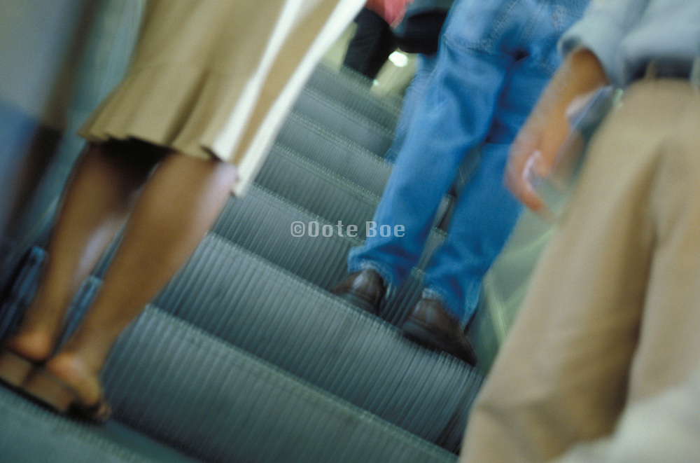 legs going up escalator