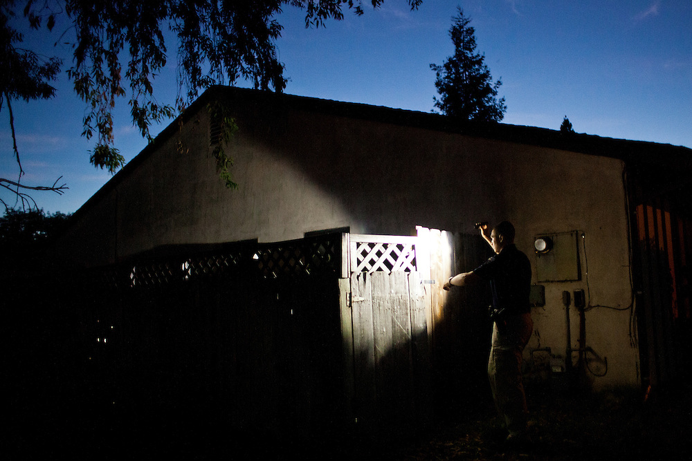 Delta Haweye Security guard Darien Wilson patrols foreclosed homes in Stockton, Calif., July 11, 2012. The bankrupt city has cut back on many services, while residents and private contractors are picking up the slack.