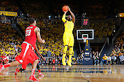 ANN ARBOR, MI - FEBRUARY 5: Tim Hardaway Jr. #10 of the Michigan Wolverines shoots the open jumper against the Ohio State Buckeyes during the game at Crisler Center in Ann Arbor, Michigan on February 5. Michigan won 76-74. (Photo by Joe Robbins)