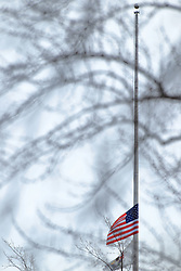 11 February 2017:  A top the famed Starved Rock, the American Flag flies at half mast Starved Rock State Park in Illinois as the water churns below