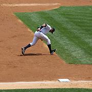 Alex Rodriguez making an error while fielding at third base during the New York Yankees V Detroit Tigers Major League Baseball regular season baseball game at Yankee Stadium, The Bronx, New York. 11th August 2013. Photo Tim Clayton