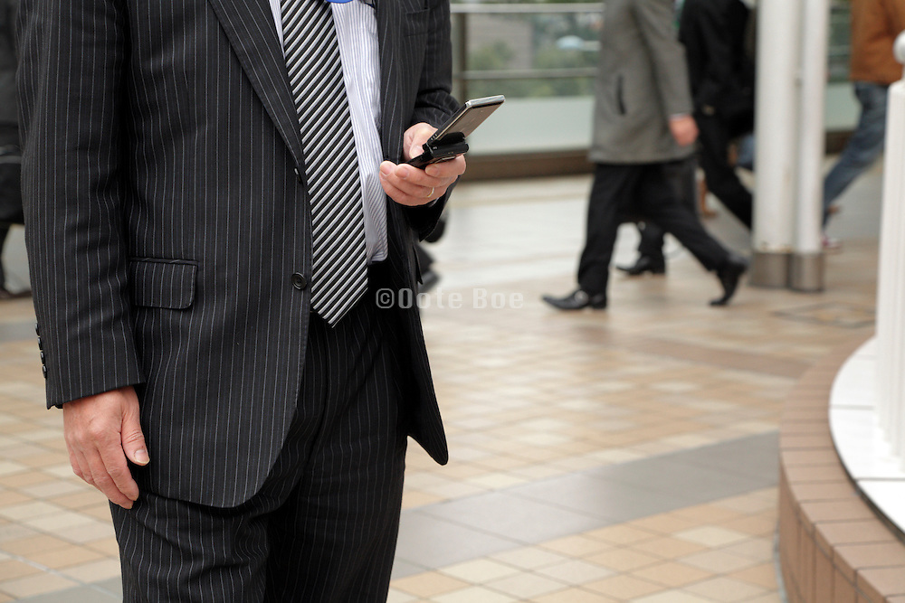 businessman checking his messages on his mobile phone