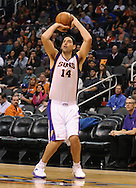 Dec. 17, 2012; Phoenix, AZ, USA; Phoenix Suns forward Luis Scola (14) shoots the ball during the game against the Sacramento Kings in the second half at US Airways Center. The Suns defeated the Kings 101-90.  Mandatory Credit: Jennifer Stewart-USA TODAY Sports