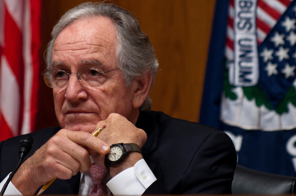 "Senate Health, Education, Labor and Pensions Committee Chairman TOM HARKIN (D-IA) motions to his watch to inform a witness that their time has expired during a hearing on ""The Endangered Middle Class: Is the American Dream Slipping Out of Reach for American Families?"""