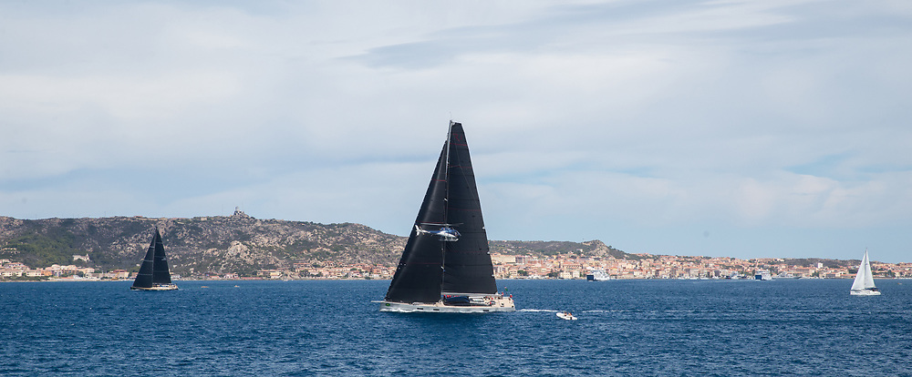 RIBELLE with a helicopter during the Rolex Maxi Cup 2017, Costa Smeralda, Porto Cervo Yacht Club Costa Smeralda (YCCS).