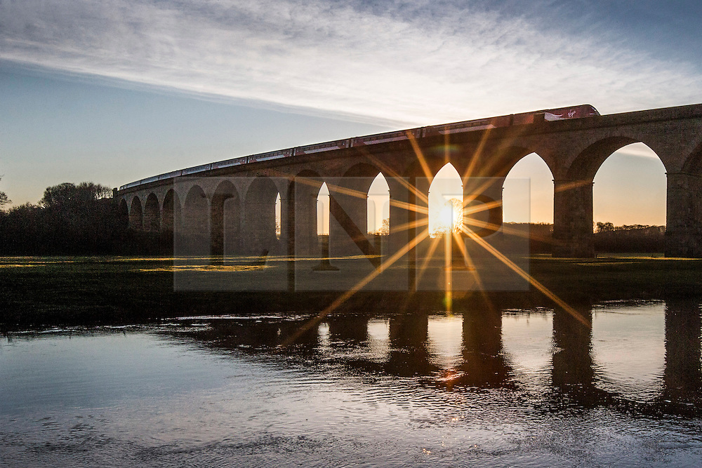 © Licensed to London News Pictures. 03/03/2016. Arthington UK.  A commuter train travels across the Arthington Viaduct near Otley this morning as Yorkshire woke to a beautiful sunrise. Photo credit: Andrew McCaren/LNP