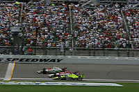 Tony Kanaan beats Dan Wheldon and Vitor Meira to the finish line at the Kansas Speedway, Kansas Indy 300, July 3, 2005
