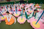 The annual Lotus Lantern Festival is held to celebrate Buddha's Birthday. Opening ceremony for the parade at Dongdaemun Stadium. Dancers with lotus flower umbrellas.