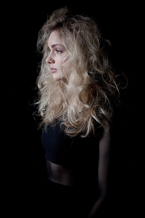 profile of woman with black background