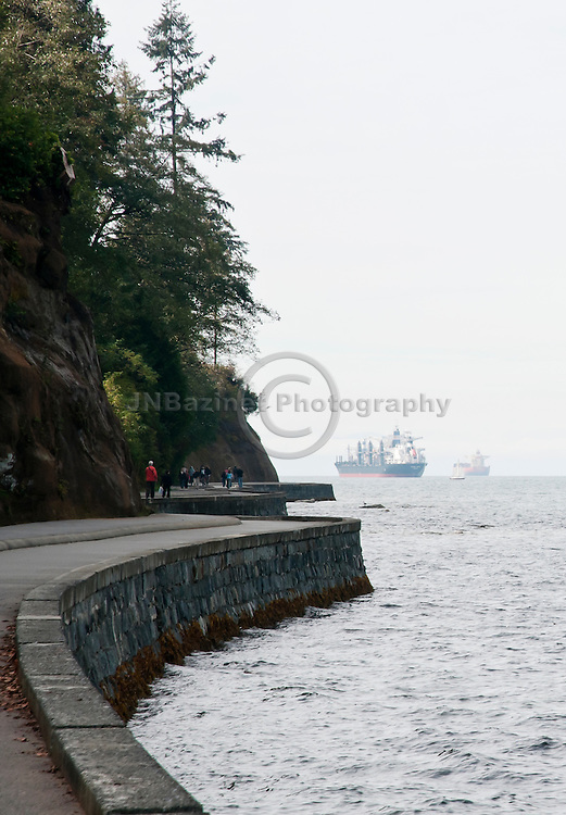 A walk path lines the seawall of Stanley Park.