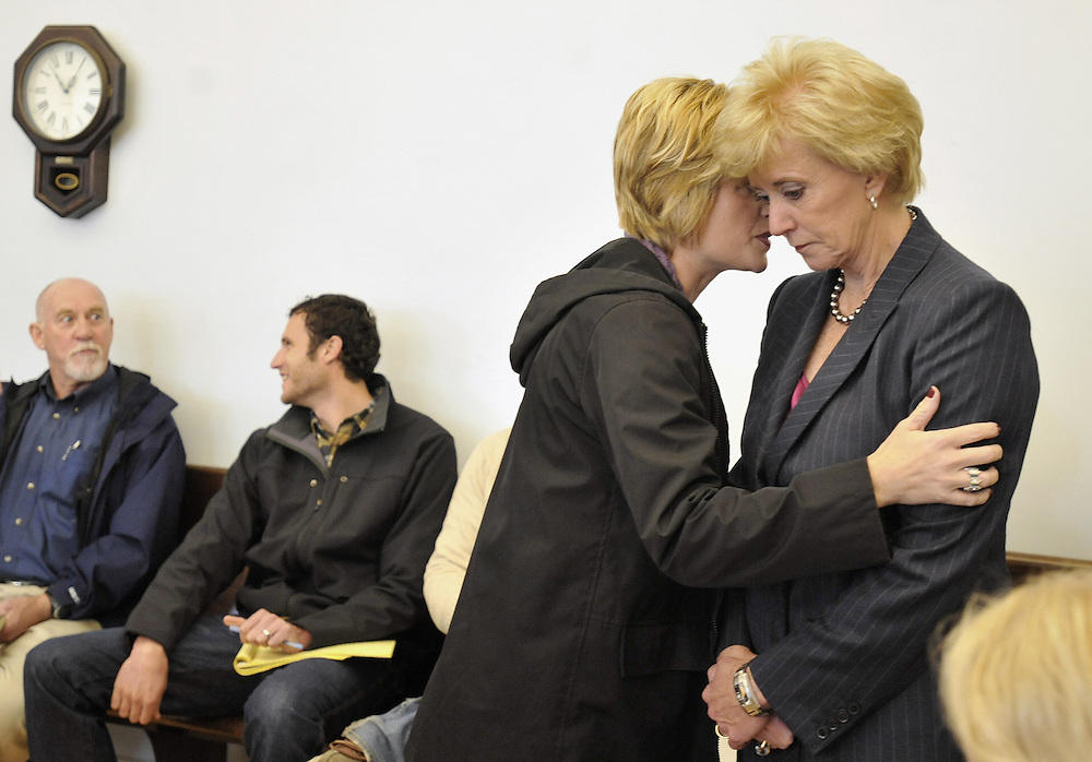 Republican candidate for U.S. Senate Linda McMahon, right, and director of new media for McMahon's campaign, Jodi Latina speak prior to a candidate forum at a senior center in Manchester, Conn., Thursday, Oct. 21, 2010. Former World Wrestling Entertainment CEO McMahon is battling Richard Blumenthal, the Connecticut  Attorney General, for the senate seat being vacated by the retiring Sen. Chris Dodd.  (AP Photo/Jessica Hill)