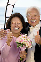 Happy Parents at Wedding Giving Thumbs-Up