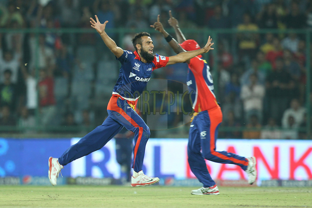 Imran Tahir of the Delhi Daredevils celebrates the wicket of Mitchell McClenaghan of the Mumbai Indians during match 21 of the Pepsi IPL 2015 (Indian Premier League) between The Delhi Daredevils and The Mumbai Indians held at the Ferozeshah Kotla stadium in Delhi, India on the 23rd April 2015.<br /> <br /> Photo by:  Deepak Malik / SPORTZPICS / IPL