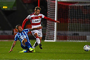Blackpool midfielder Jay Spearing (8) tackles Doncaster Rovers midfielder Kieran Sadlier (7) during the EFL Sky Bet League 1 match between Doncaster Rovers and Blackpool at the Keepmoat Stadium, Doncaster, England on 17 September 2019.