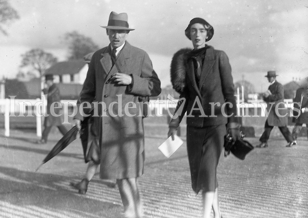 A couple at the Horse racing, names, dates and location unknown. (Part of the Independent Newspapers Ireland/NLI collection.)