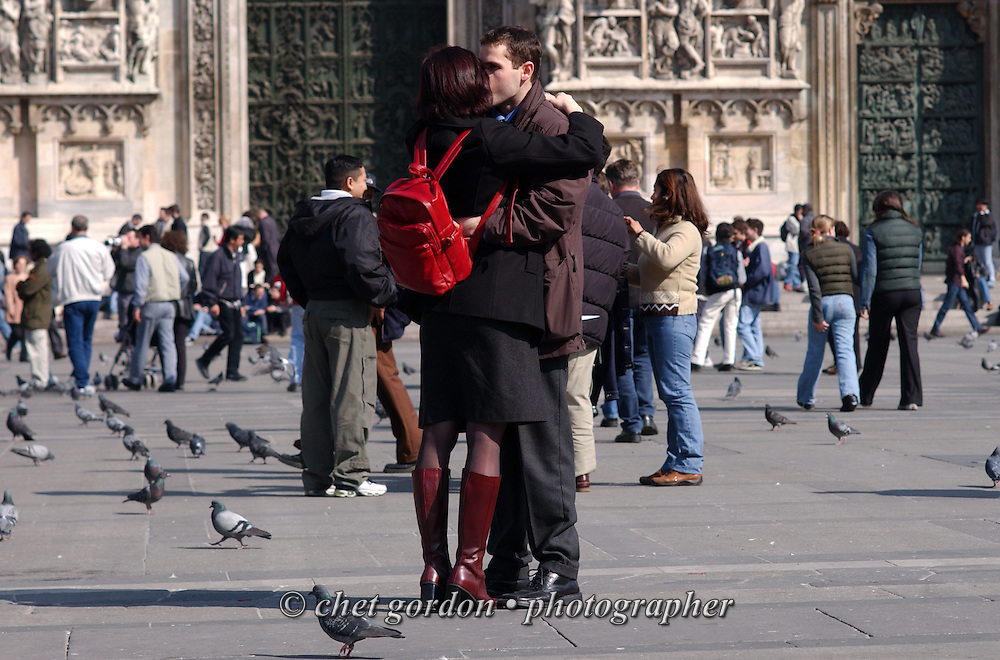 An Italian couple kiss near the Duomo in Milan, Italy. March 2002.