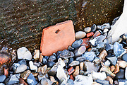 Red clay roof tile, medieval or Tudor, found on the Thames River foreshore, London, UK