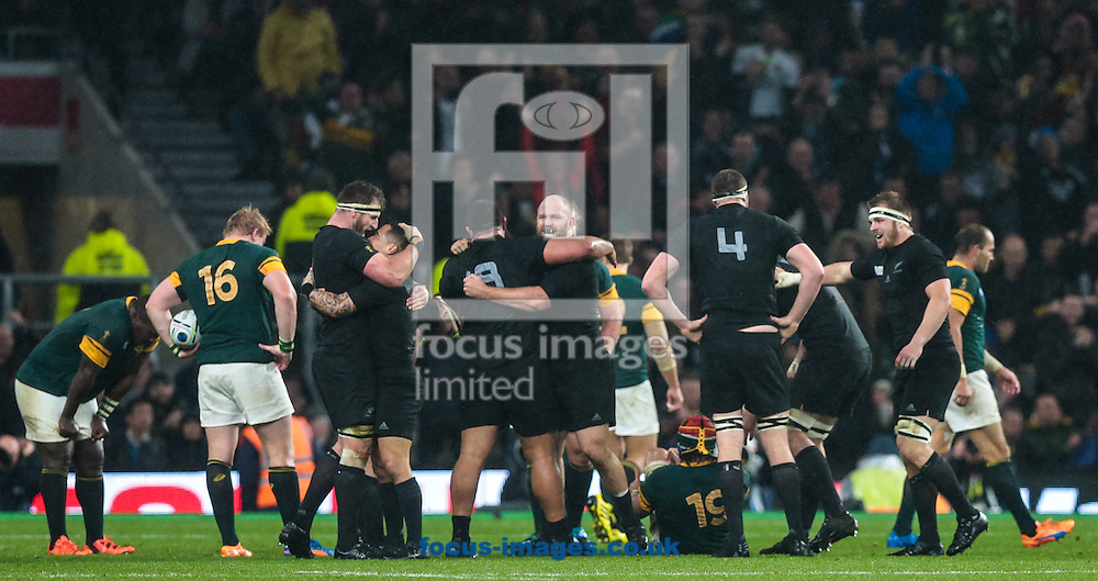 New Zealand players celebrate winning the 2015 Rugby World Cup semi final match at Twickenham Stadium, Twickenham<br /> Picture by Michael Whitefoot/Focus Images Ltd 07969 898192<br /> 24/10/2015