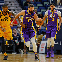 Feb 5, 2018; New Orleans, LA, USA; New Orleans Pelicans forward Nikola Mirotic (3) drives past Utah Jazz forward Derrick Favors (15) during the first quarter at the Smoothie King Center. Mandatory Credit: Derick E. Hingle-USA TODAY Sports