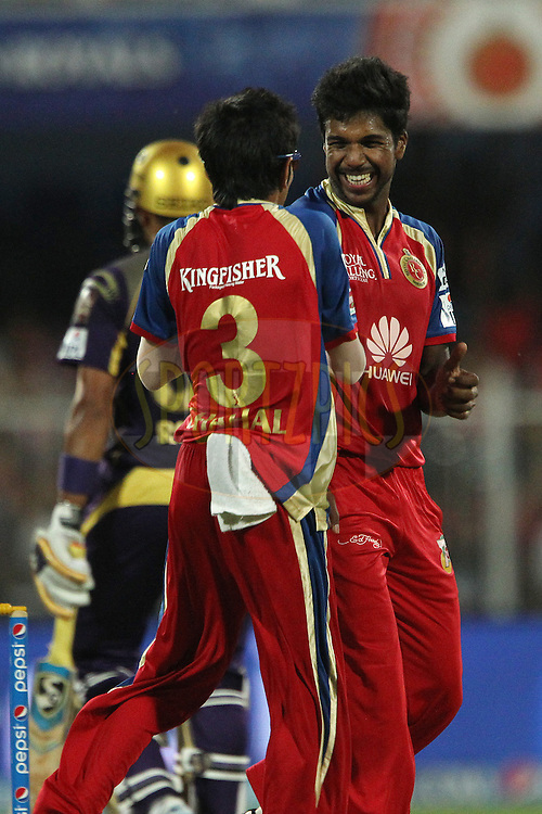 Varun Aaron of the Royal Challengers Bangalore celebrates the wicket of Robin Uthappa of the Kolkata Knight Riders during match 11 of the Pepsi Indian Premier League 2014 between the The Royal Challengers Bangalore and the Kolkata Knight Riders  held at the Sharjah Cricket Stadium, Sharjah, United Arab Emirates on the 24th April 2014<br /> <br /> Photo by Ron Gaunt / IPL / SPORTZPICS