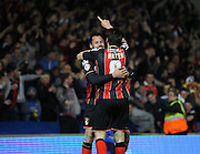 AFC Bournemouth midfielder Harry Arter celebrates with AFC Bournemouth defender Adam Smith during the Sky Bet Championship match between Brighton and Hove Albion and Bournemouth at the American Express Community Stadium, Brighton and Hove, England on 10 April 2015. Photo by Phil Duncan.