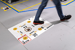 """© Licensed to London News Pictures . 04/12/2019. Manchester , UK . Manchester bee branded delivery badges on the floor inside the """"MAN1"""" Amazon fulfilment centre warehouse at Manchester Airport in the North West of England . Photo credit : Joel Goodman/LNP"""