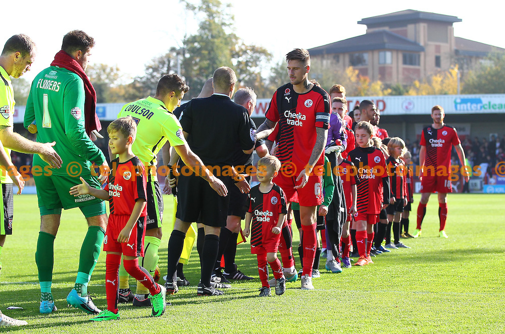 Mascots meet the players during the Sky Bet League 2 match between Crawley Town and York City at the Checkatrade.com Stadium in Crawley. October 31, 2015.<br /> James Boardman / Telephoto Images<br /> +44 7967 642437