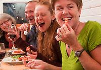 Locals enjoy seafood and wine at the Alaska Fish House, Ketchikan, Alaska