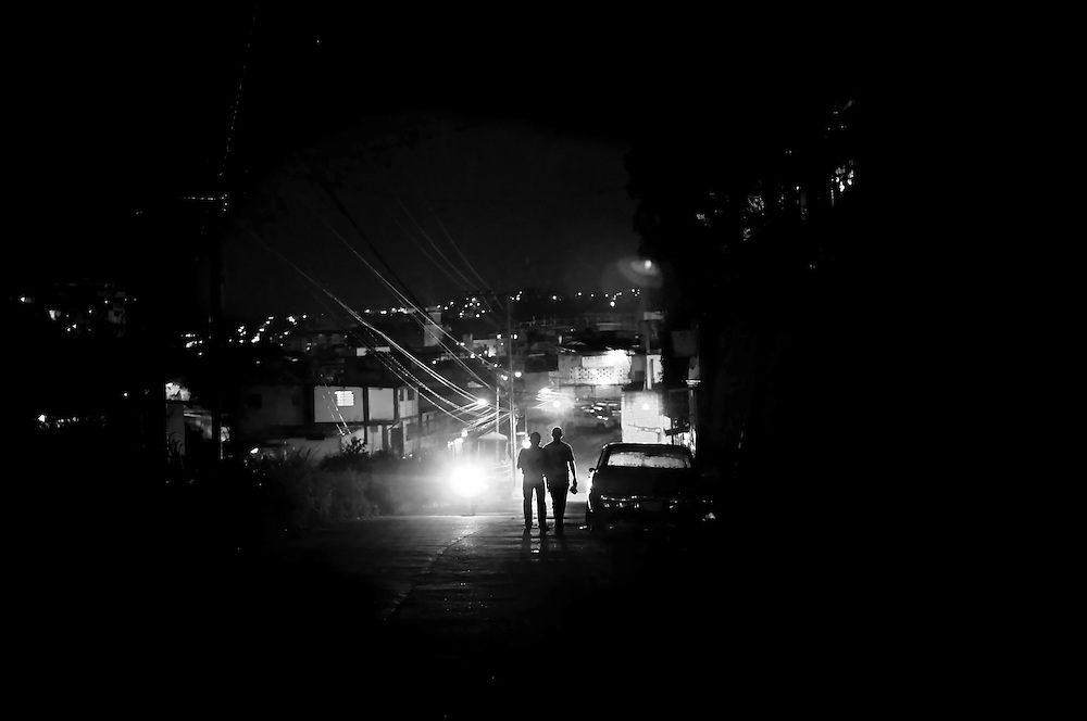 Street scene at night in Petare. Petare slum is one of the most violent areas of Caracas, Venezuela, reporting over a dozen homicides every weekend. According to the ngo, the Venezuelan Observatory of Violence (OVV), Caracas has one of the highest violent crime rates in the world, with two people murdered every hour, a homicide rate that has quadrupled over the eleven year presidency of Hugo Chávez. Equally disturbing is the level of impunity, corruption and incompetency in the Venezuelan judicial system. OVV reports that 91% of crimes go unsolved in Venezuela.