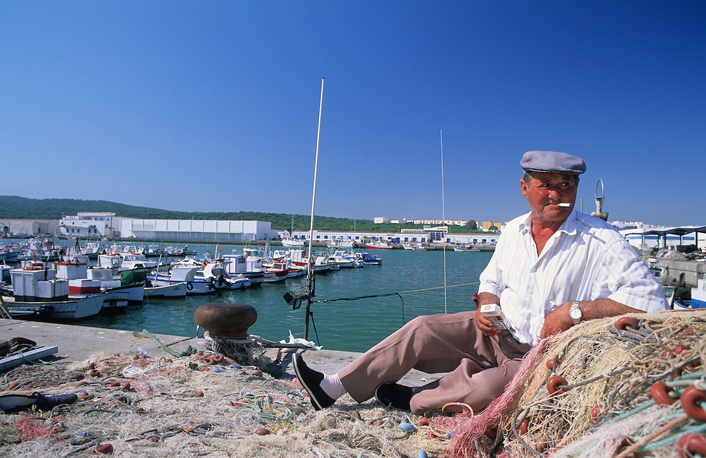 Old Spanish man in Barbate harbour, Costa de la Luz, Spain