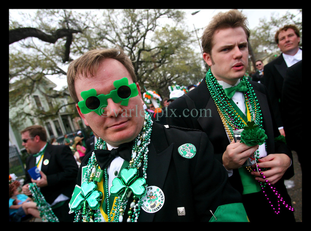 March 11th, 2006. New Orleans, Louisiana. The St Patrick's Day parade makes its way down Louisiana Avenue in Uptown New Orleans, dispensing beads, throws and vegetables, including potatoes, cabbages and carrots with various other food to residents gathered for the occasion.