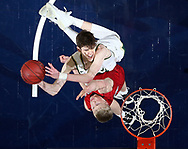 Iowa City West's Patrick McCaffery (22) is fouled by Cedar Falls' Logan Wolf (10) as he shoots during the fourth quarter of the 4A Championship game of the Iowa Boys' State Basketball Tournament at Wells Fargo Arena in Des Moines on Friday, Mar. 9, 2018.