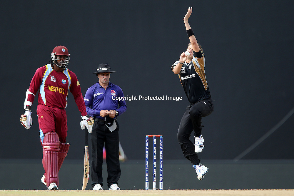 Tim Southee bowls as Chris Gayle of The West Indies prepares to run during the ICC World Twenty20 Super Eights match between The West Indies and New Zealand held at the  Pallekele Stadium in Kandy, Sri Lanka on the 1st October 2012<br /> <br /> Photo by Ron Gaunt/SPORTZPICS/PHOTOSPORT
