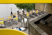 Decaying gray concrete and freshly-painted yellow theme on London's Southbank.
