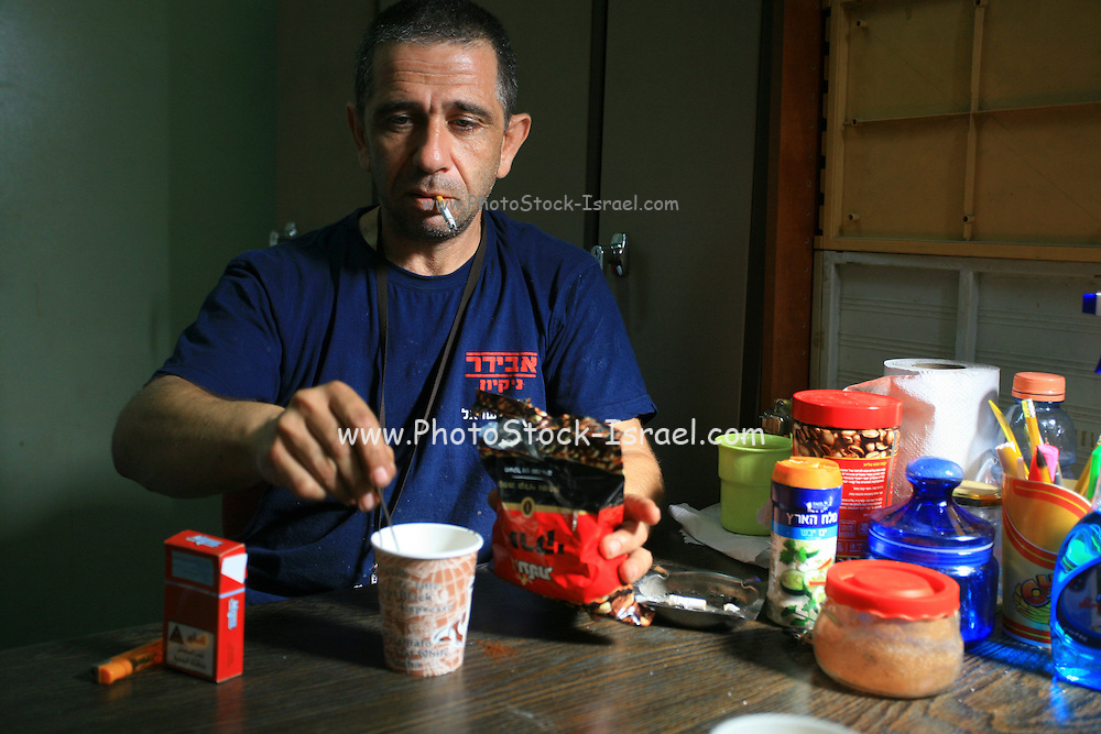 Israeli Rail maintenance workers during a coffee break at the storeroom at the Tel Aviv Railway station