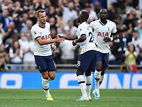 Football - 2019 / 2020 Premier League - Tottenham Hotspur vs. Aston Villa<br /> <br /> Tottenham Hotspur's Tanguy Ndombele (centre) celebrates scoring his side's equalising goal with Harry Kane to make the score 1-1, at The Tottenham Hotspur Stadium.<br /> <br /> COLORSPORT/ASHLEY WESTERN