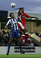 Photo: Paul Thomas.<br /> Chester City v Swindon Town. Coca Cola League 2. 01/09/2006.<br /> <br /> Drewe Broughton (L) of Chester competes with Jerel Ifil for the ball.
